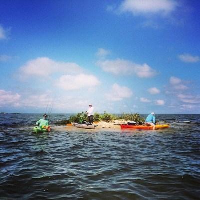 Kayaks around island in the gulf